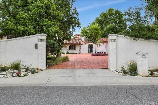 23130 Oxnard Street, Woodland Hills, CA 91367 (#SR20104997) :: The Costantino Group | Cal American Homes and Realty