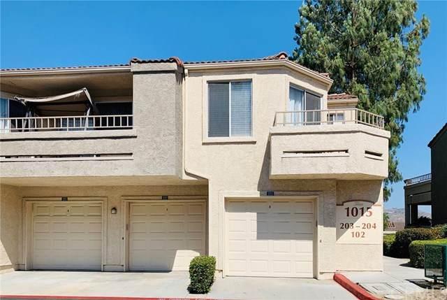 1015 Vista Del Cerro Drive #203, Corona, CA 92879 (#IG20106999) :: RE/MAX Masters