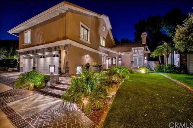 7166 Columbus Drive, Anaheim Hills, CA 92807 (#PW20118361) :: Team Tami