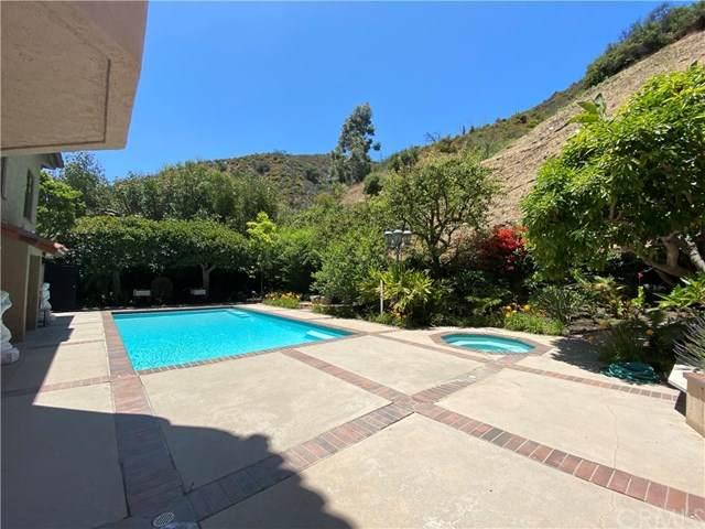 1345 Moraga Drive, Los Angeles (City), CA 90049 (#AR20127623) :: Z Team OC Real Estate