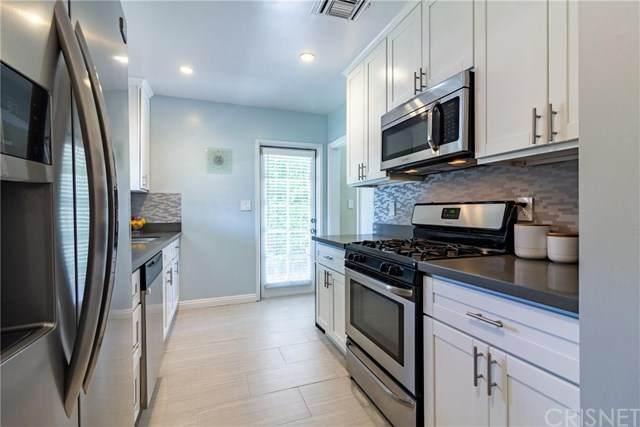 15027 Hartland Street, Van Nuys, CA 91405 (#SR20128750) :: A G Amaya Group Real Estate