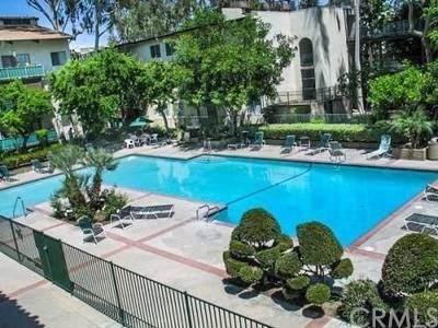 5460 White Oak Avenue A214, Encino, CA 91316 (#AR20130562) :: Doherty Real Estate Group