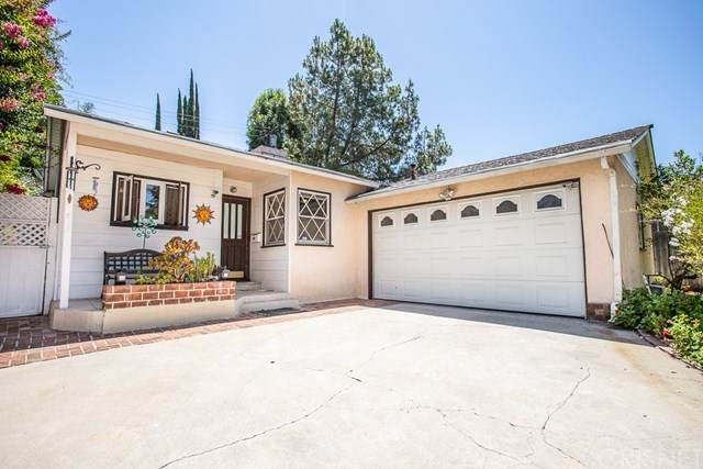 4636 Santa Lucia Drive, Woodland Hills, CA 91364 (#SR20135576) :: The Marelly Group | Compass