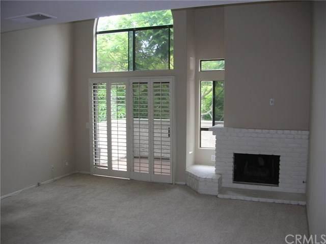 17202 Corbina Lane #205, Huntington Beach, CA 92649 (#OC20152643) :: Doherty Real Estate Group