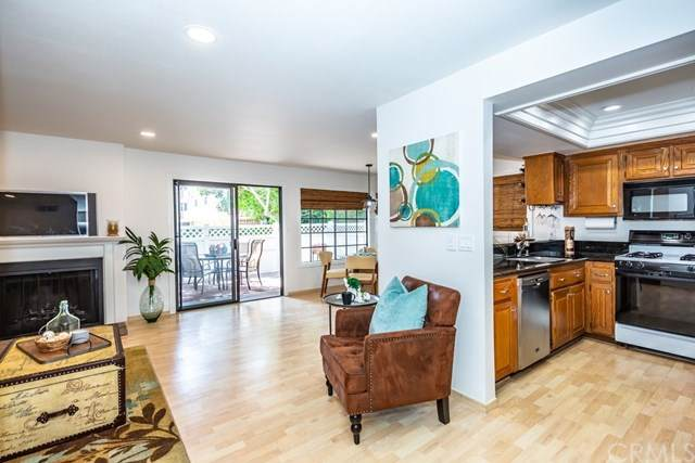 4682 Warner Avenue A102, Huntington Beach, CA 92649 (#PW20151355) :: Sperry Residential Group