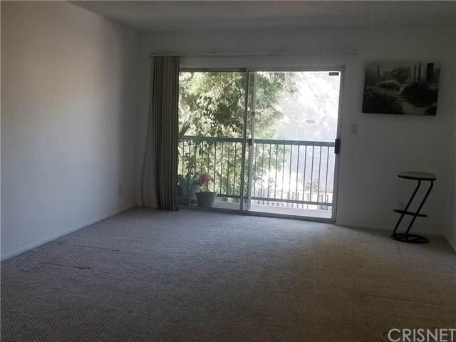 18307 Burbank Boulevard #108, Tarzana, CA 91356 (#SR20196641) :: Go Gabby