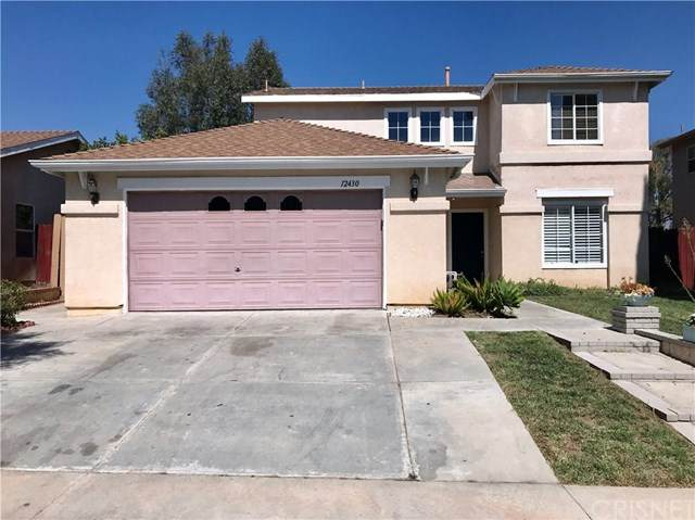 12430 Edgecliff Avenue, Sylmar, CA 91342 (#SR20204597) :: The Najar Group