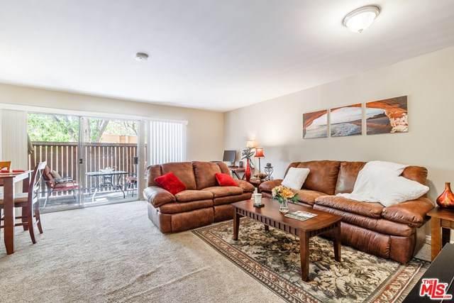 18350 Hatteras Street #125, Tarzana, CA 91356 (#20640258) :: The Brad Korb Real Estate Group