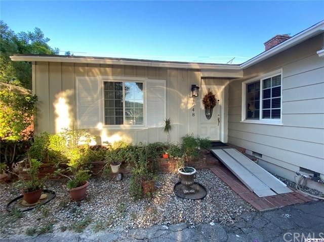 4948 Topanga Canyon Boulevard, Woodland Hills, CA 91364 (#320003712) :: The Veléz Team