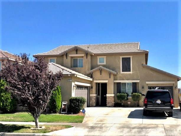 8951 Honeysuckle Avenue, Oak Hills, CA 92344 (#IV20221035) :: The Miller Group