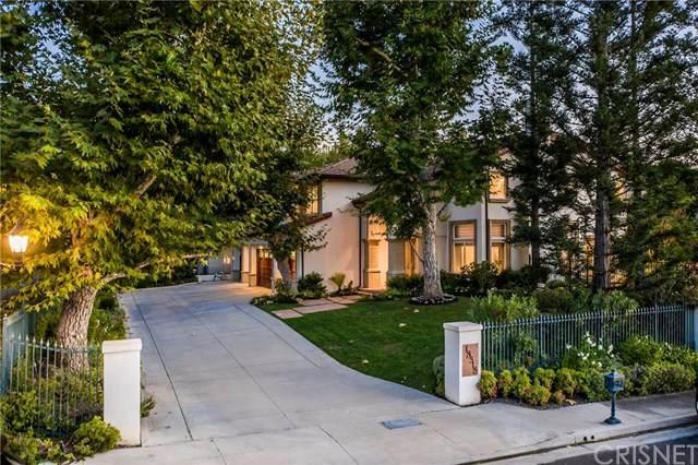 18518 Saint Moritz Drive, Tarzana, CA 91356 (#SR20218369) :: The Miller Group