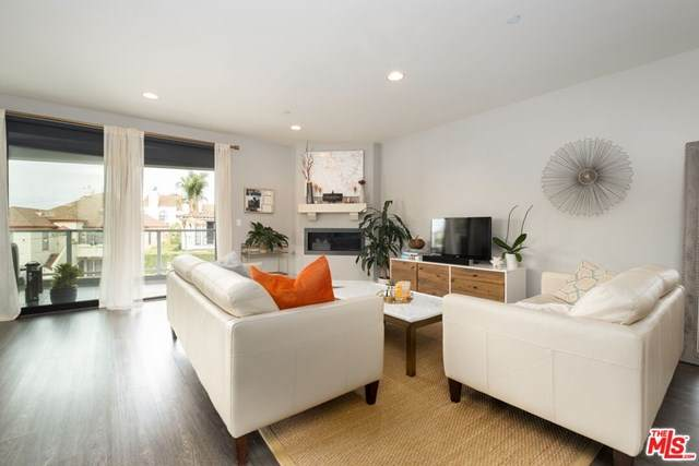 5826 W Olympic #201, Los Angeles (City), CA 90036 (#20652060) :: Z Team OC Real Estate