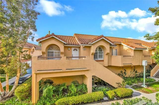 125 Costero Aisle #275, Irvine, CA 92614 (#OC20244785) :: Berkshire Hathaway HomeServices California Properties