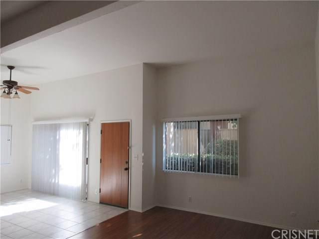 18445 Hatteras Street #301, Tarzana, CA 91356 (#SR20246421) :: American Real Estate List & Sell
