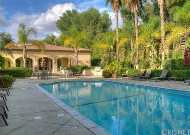 5250 Premiere Hills Circle #102, Woodland Hills, CA 91364 (#SR20247428) :: Bathurst Coastal Properties