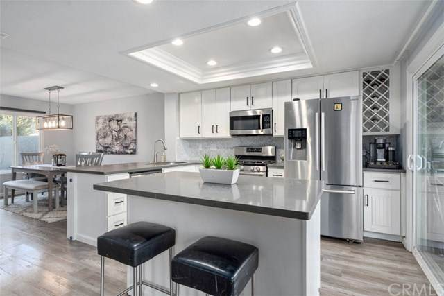 8478 Oakstone Circle, Huntington Beach, CA 92646 (#OC21013235) :: Legacy 15 Real Estate Brokers