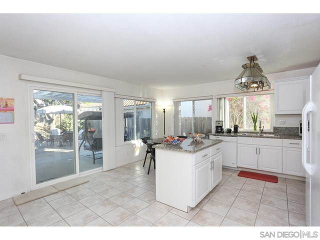 10235 Kamwood Place, San Diego, CA 92126 (#210004779) :: Millman Team