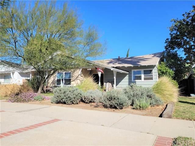 9340 Woodley Avenue, North Hills, CA 91343 (#SR21039962) :: Millman Team