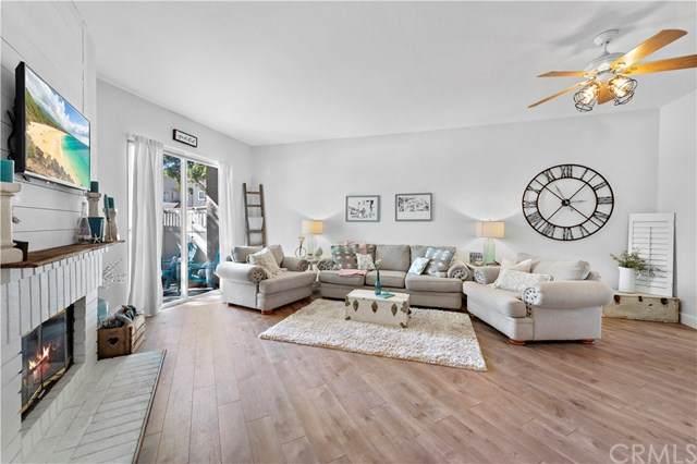 24347 Marquis Court #303, Laguna Hills, CA 92653 (#OC21040319) :: Berkshire Hathaway HomeServices California Properties