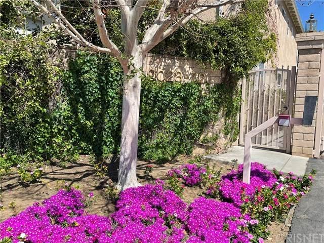9070 Hayvenhurst Avenue, North Hills, CA 91343 (#SR21065331) :: Koster & Krew Real Estate Group | Keller Williams