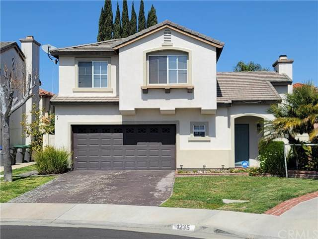 1235 E 215th Place, Carson, CA 90745 (#OC21076448) :: The Parsons Team