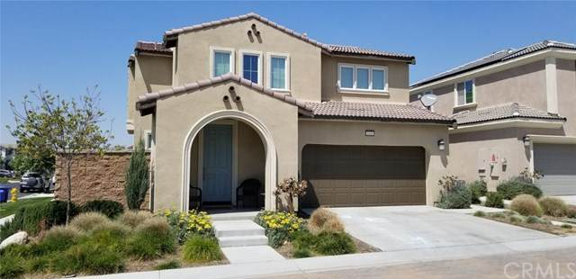 3201 E Olympic Drive, Ontario, CA 91762 (#CV21083856) :: Team Forss Realty Group