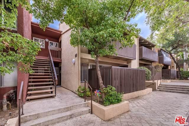 18350 Hatteras Street #128, Tarzana, CA 91356 (#21724750) :: Mainstreet Realtors®
