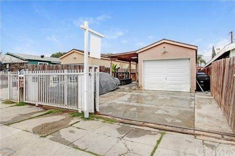 1933 E 114th Street, Los Angeles (City), CA 90059 (#DW21094175) :: The Costantino Group | Cal American Homes and Realty