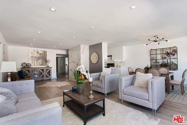 11733 Goshen Avenue #205, Los Angeles (City), CA 90049 (#21727648) :: The Kohler Group