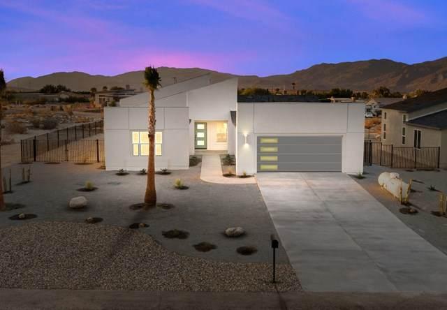 67654 Roundup Drive, Desert Hot Springs, CA 92241 (#219061567DA) :: Compass