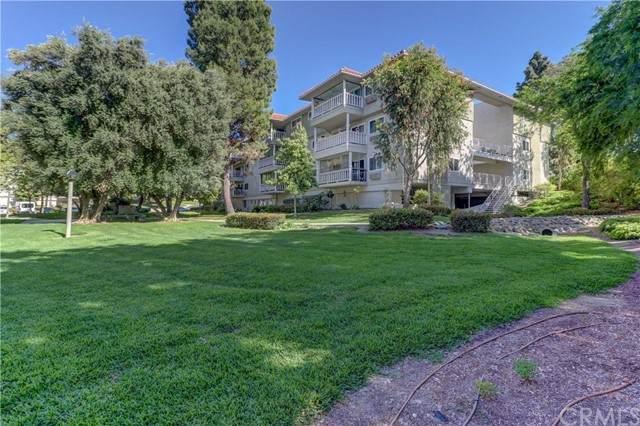 2403 Via Mariposa W 3A, Laguna Woods, CA 92637 (#OC21067238) :: Pam Spadafore & Associates