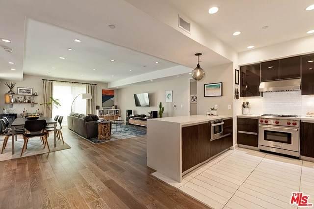 441 S Barrington Avenue #408, Los Angeles (City), CA 90049 (#21729806) :: Frank Kenny Real Estate Team