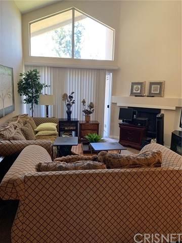 21550 Burbank Boulevard #303, Woodland Hills, CA 91367 (#SR21127652) :: The Laffins Real Estate Team