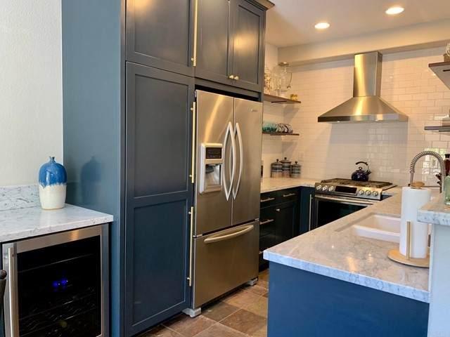6494 Terraza Portico, Carlsbad, CA 92009 (#NDP2106969) :: Powerhouse Real Estate