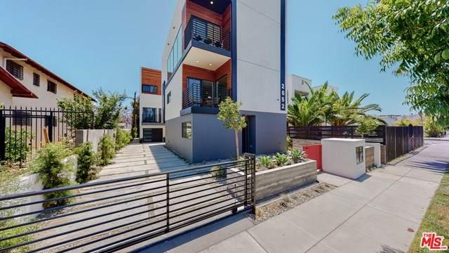 2652 S Mansfield Avenue, Los Angeles (City), CA 90016 (#21749862) :: Necol Realty Group