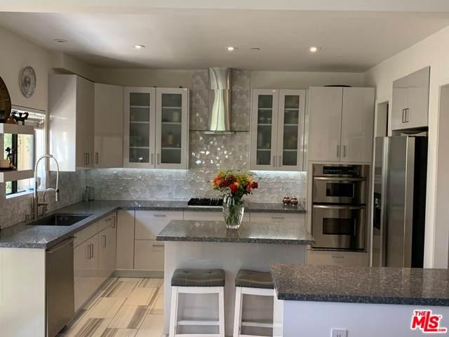 720 Huntley Drive #104, West Hollywood, CA 90069 (#21750082) :: Blake Cory Home Selling Team