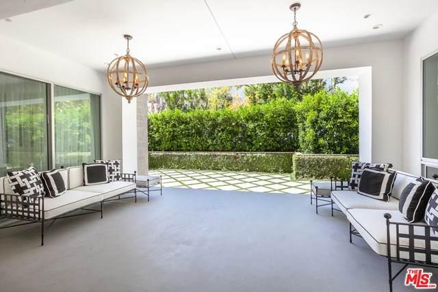 460 N Palm Drive #106, Beverly Hills, CA 90210 (#21750372) :: TeamRobinson | RE/MAX One