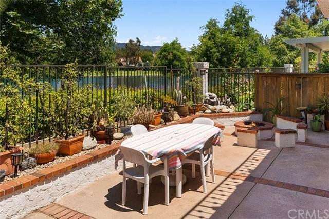 2 Vista Lago #15, Rancho Santa Margarita, CA 92688 (#OC21130090) :: Veronica Encinas Team
