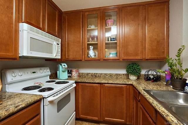 7737 Margerum Avenue #105, San Diego, CA 92120 (#210017080) :: Blake Cory Home Selling Team
