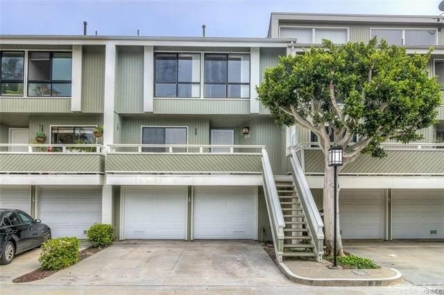 20 Barlovento Court #8, Newport Beach, CA 92663 (#LG21133736) :: Holmes Muirhead Team at Reviron Realty