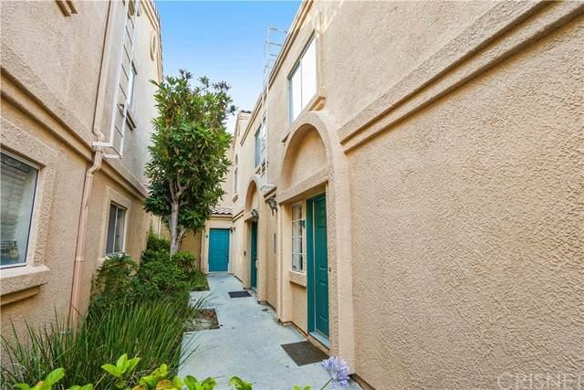 18848 Vista Del Canon E, Newhall, CA 91321 (#SR21133097) :: American Real Estate List & Sell