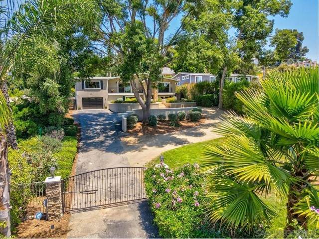 1454 Via Rancho Pkwy, Escondido, CA 92029 (#210019487) :: Zutila, Inc.