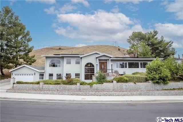 12352 Woodley Avenue, Granada Hills, CA 91344 (#320006847) :: Cochren Realty Team | KW the Lakes