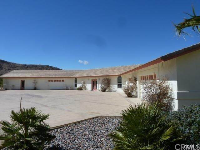 70410 Cottonwood Drive, 29 Palms, CA 92277 (#CV21234399) :: The Miller Group