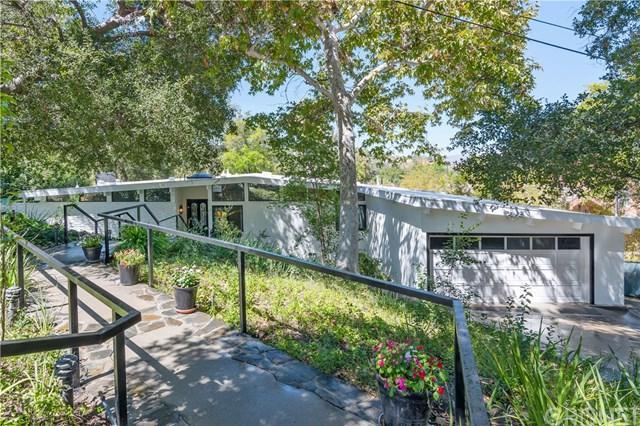 22133 Mulholland Drive, Woodland Hills, CA 91364 (#SR18228902) :: Barnett Renderos