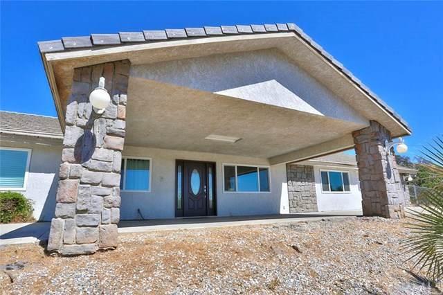 7686 Oak Hill Road, Oak Hills, CA 92344 (#IV20106880) :: Crudo & Associates