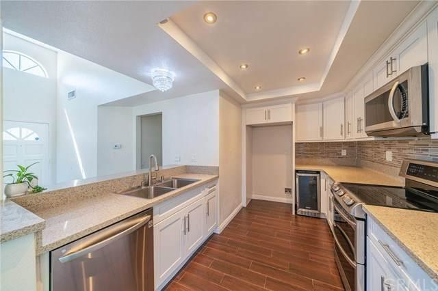 95 Remington #218, Irvine, CA 92620 (#OC20147420) :: Allison James Estates and Homes