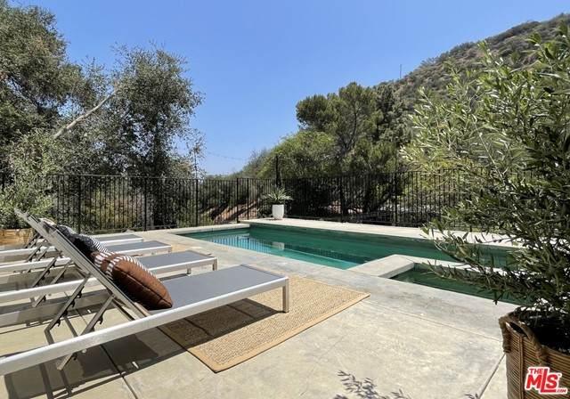 8569 Lookout Mountain Avenue, Los Angeles (City), CA 90046 (#21732444) :: CENTURY 21 Jordan-Link & Co.