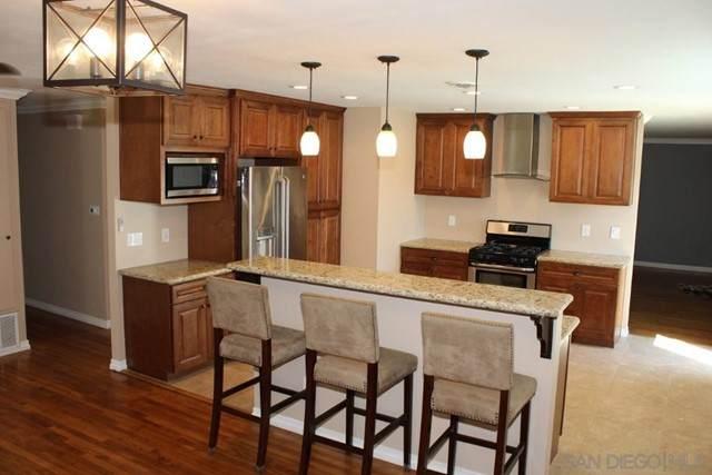 6904 Ballinger Ave., San Diego, CA 92119 (#210015802) :: Wahba Group Real Estate | Keller Williams Irvine