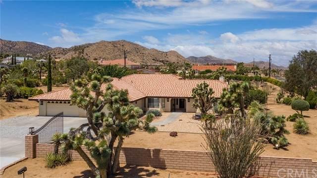 9254 Del Monte Avenue, Yucca Valley, CA 92284 (#JT21121018) :: Compass